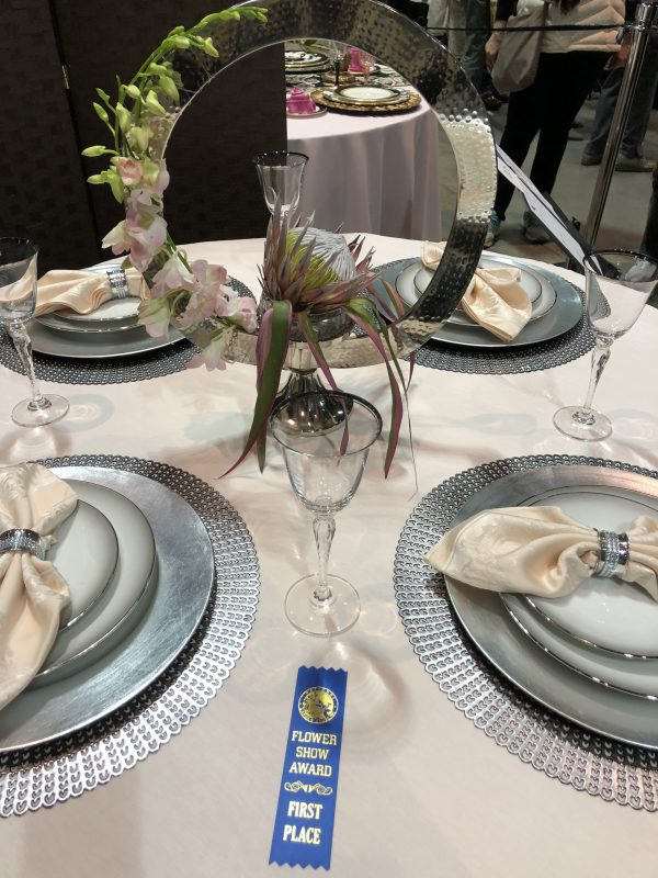 First place table setting design! Silver and pale peach color scheme.