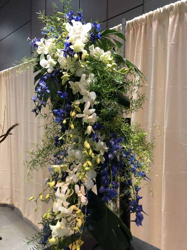 Beautiful cascading blue, white and green floral arrangement!