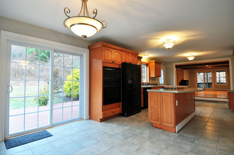 Open floor plan, Kitchen with sliders to deck and patio.