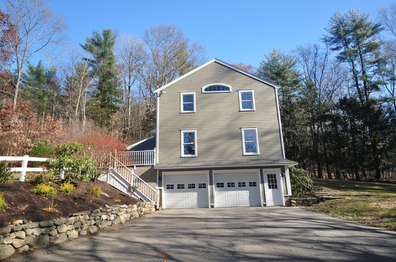 Exterior side, stone wall, fence, garden, ample parking.